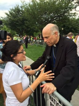 Archbishop Cordileone speaks to a reporter after addressing the crowd at the Marriage March
